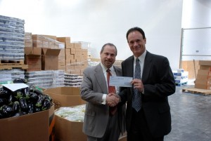 Dan Mogin presents check to Feeding America San Diego's Gary McDonald